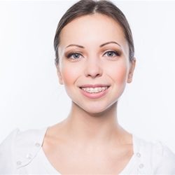 young lady with clear ceramic braces