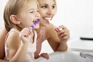 Mom Daughter brushing teeth