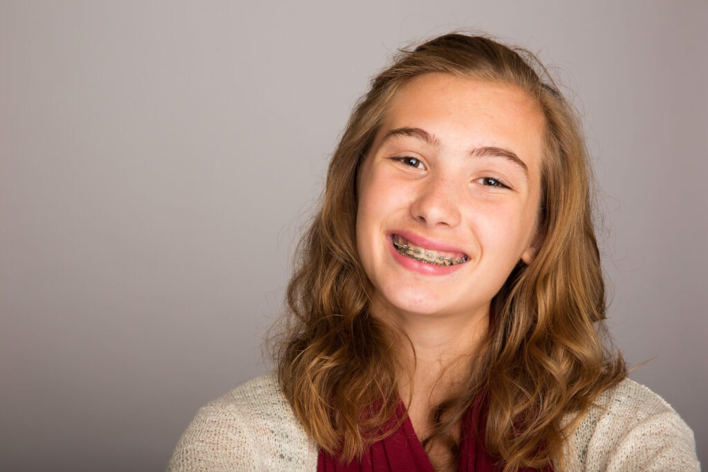 smiling teenage girl wearing braces