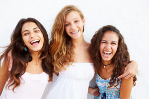 Teen girls smiling