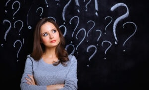 Women with question marks above her head