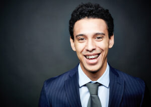 Young man in suit with braces
