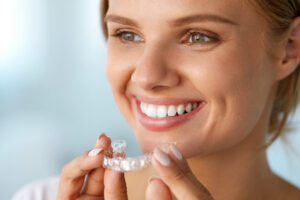 Young blonde lady with Invisalign
