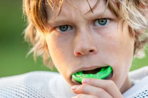 Football player using a mouthguard