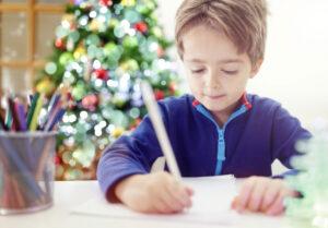 little boy writing to Santa