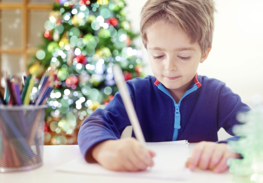 little boy writing to Santa